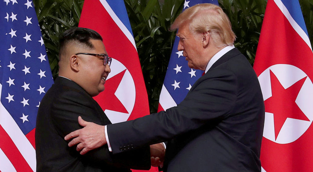 U.S. President Donald Trump shakes hands with North Korean leader Kim Jong Un at the Capella Hotel on Sentosa island in Singapore on June 12. Photo by Jonathan Ernst/Reuters