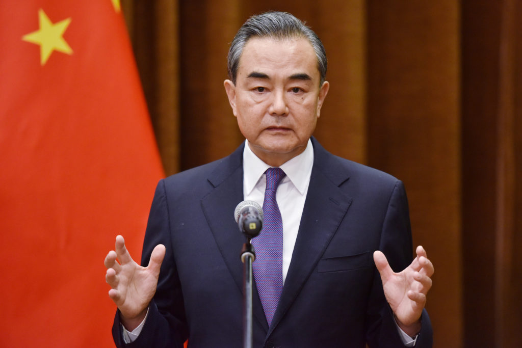 Chinese Foreign Minister Wang Yi speaks about the summit between US President Donald Trump and North Korean leader Kim Jong Un, during a joint briefing with Association of South East Asian Nations (ASEAN) Secretary-General Lim Jock Hoi at the Foreign Ministry in Beijing, China. Photo by Greg Baker/Reuters
