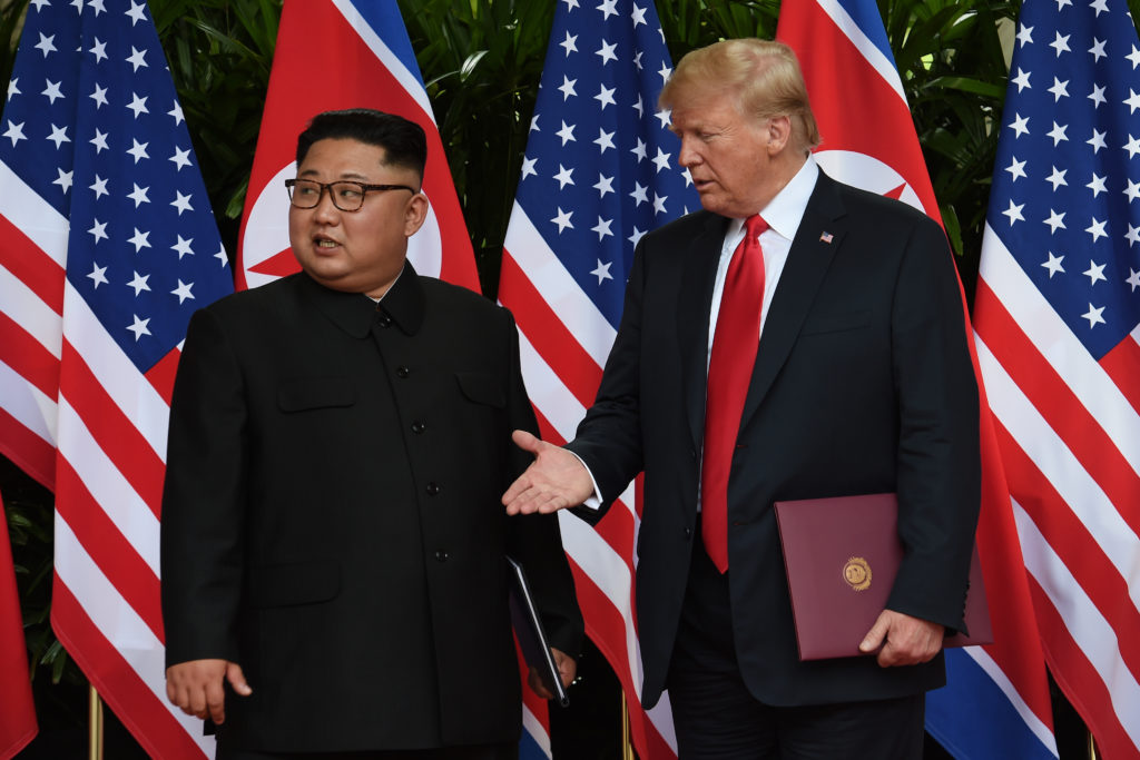 North Korea's leader Kim Jong Un and President Donald Trump meet in Singapore on June 12. Photo by Anthony Wallace/Reuters