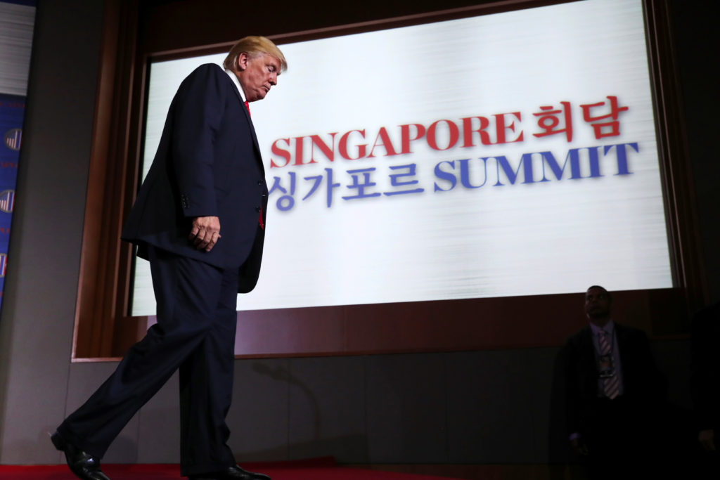 President Donald Trump walks off the stage after a news conference after his meeting with North Korean leader Kim Jong Un ...