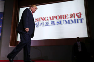 President Donald Trump walks off the stage after a news conference after his meeting with North Korean leader Kim Jong Un at the Capella Hotel on Sentosa island in Singapore. Photo by Jonathan Ernst/Reuters