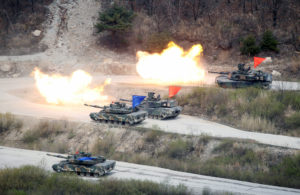 South Korean Army K1A1 and U.S. Army M1A2 tanks fire live rounds during a U.S.-South Korea joint live-fire military exercise, at a training field, near the demilitarized zone, separating the two Koreas in Pocheon, South Korea on April 21, 2017. File photo by Kim Hong-Ji/Reuters