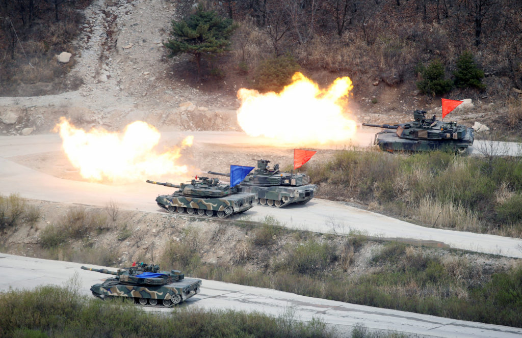 South Korean Army K1A1 and U.S. Army M1A2 tanks fire live rounds during a U.S.-South Korea joint live-fire military exercise, at a training field, near the demilitarized zone, separating the two Koreas in Pocheon, South Korea. Photo by Kim Hong-Ji/Reuters