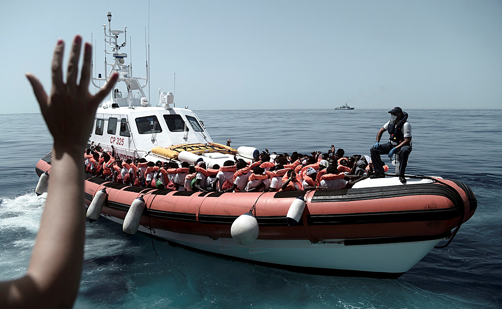 Migrants are seen after being rescued by MV Aquarius, a search and rescue ship run in partnership between SOS Mediterranee and Medecins Sans Frontieres in the central Mediterranean Sea. Photo by Karpov/SOS Mediterranee via Reuters