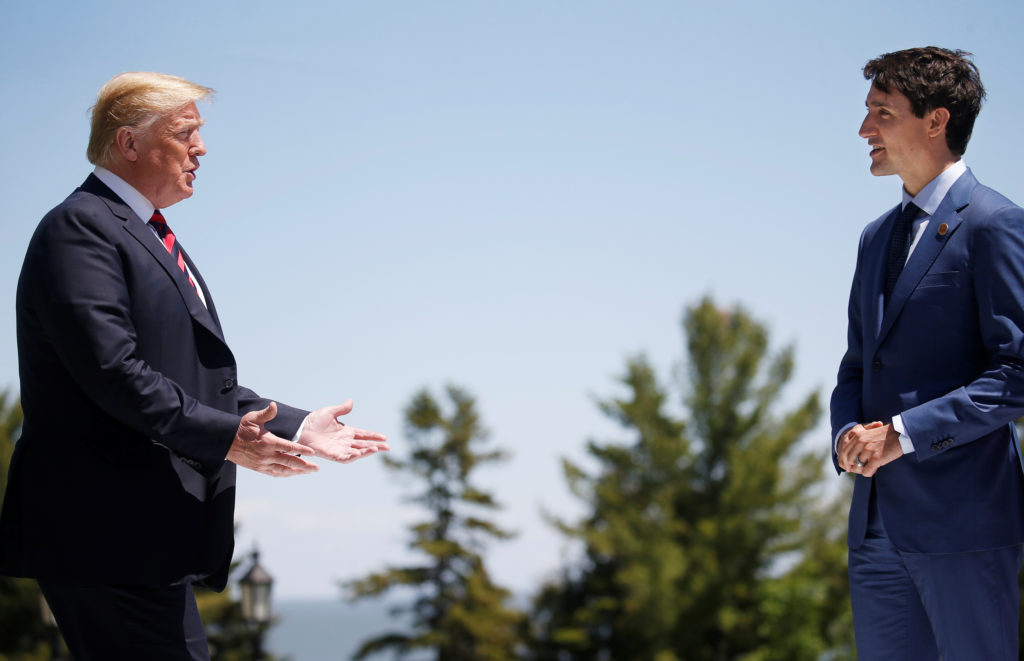 U.S. President Donald Trump approaches Canada's Prime Minister Justin Trudeau as he arrives at the G7 Summit in Charlevoix Quebec Canada