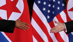 U.S. President Donald Trump and North Korea's leader Kim Jong Un meet at the start of their summit on the resort island of Sentosa, Singapore June 12, 2018. Picture taken June 12, 2018. Photo by Jonathan Ernst /Reuters