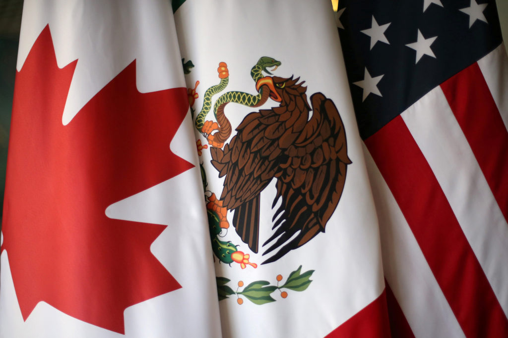 Flags are pictured during 2017 NAFTA talks involving the United States, Mexico and Canada, in Mexico City, Mexico. Photo by Edgard Garrido/Reuters