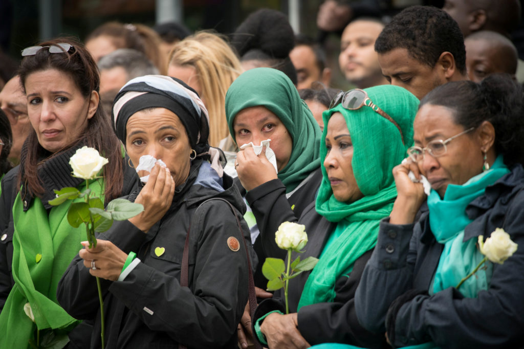 People attend the Grenfell Tower anniversary national minute of silence June 14, marking a year since the fire claimed 72 lives, in west London. Photo by Stefan Rousseau/Pool via Reuters