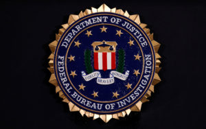 The Federal Bureau of Investigation seal is seen at FBI headquarters before a news conference by FBI Director Christopher Wray on the U.S Justice Department's inspector general's report regarding the actions of the Federal Bureau of Investigation and the 2016 U.S. presidential election in Washington, D.C. Photo by Yuri Gripas/Reuters