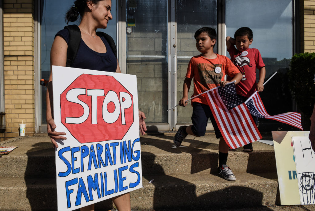 People participate in a protest against recent U.S. immigration policy that separates children from their families when entering the United States as undocumented immigrants in front of a Homeland Security facility in Elizabeth, New Jersey. Photo by Stephanie Keith/Reuters
