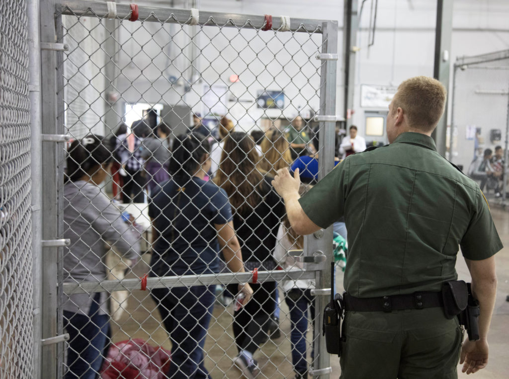 A view of inside U.S. Customs and Border Protection (CBP) detention facility shows detainees inside fenced areas at Rio Gr...