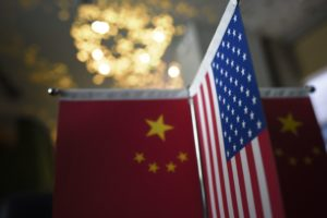 Chinese flags and American flags are displayed in a company in Beijing. After days of talks between U.S. and Chinese leaders, there are no signs of progress over key areas such as market access and theft of trade secrets. Wang Zhao/AFP/Getty Images