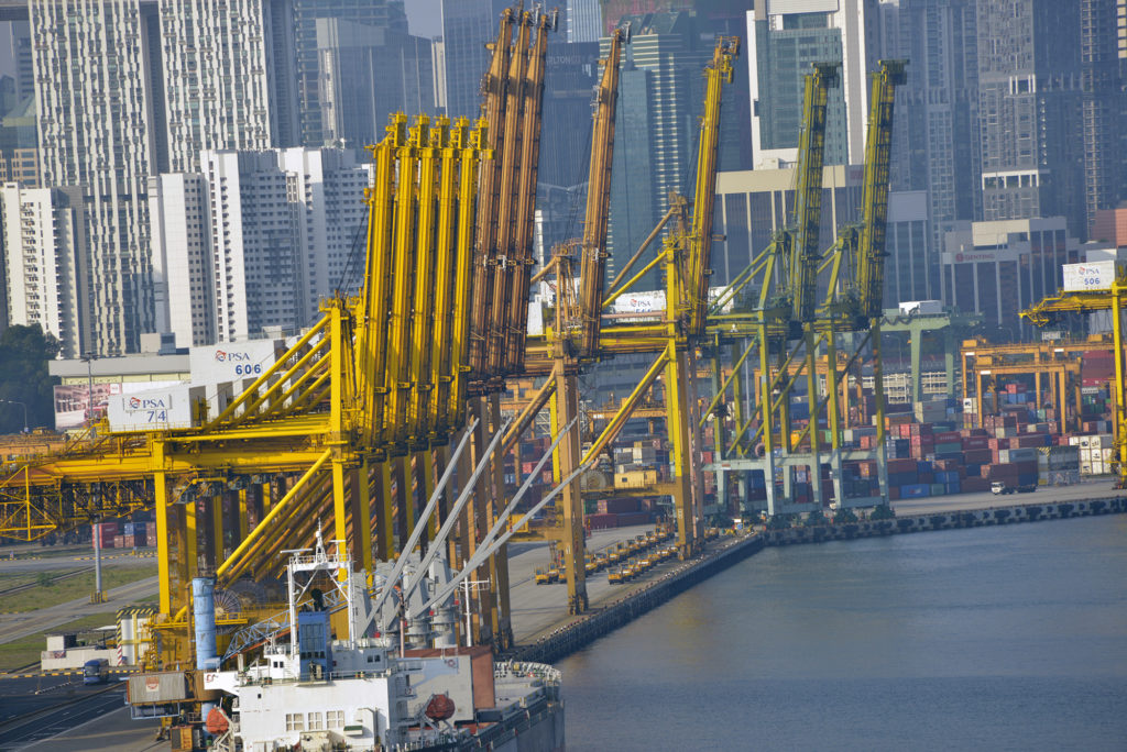 Singapore is a major trading hub in Asia. These are just some of the 200-plus cranes that load and unload more than 32 million cargo containers annually. Photo by Daniel Sagalyn/PBS NewsHour