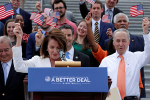"U.S. House Minority Leader Nancy Pelosi (D-CA) leads Democratic members of Congress, including Senate Minority Leader Chuck Schumer (D-NY) (R), waving flags during their ""Better Deal"" platform rally at the U.S. Capitol in Washington, U.S. May 21, 2018. REUTERS/Jonathan Ernst"