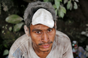 A man covered with ash after the eruption of the Fuego volcano, is seen at an area affected in the community of San Miguel Los Lotes in Escuintla, Guatemala June 5, 2018. REUTERS/Luis Echeverria TPX IMAGES OF THE DAY