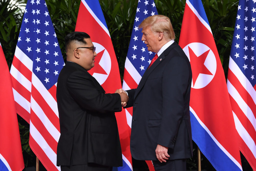 Image result for kim trump handshake