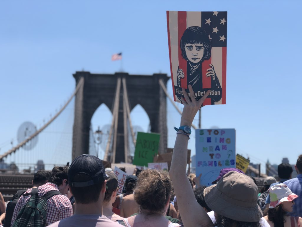 Protesters cross the Brooklyn Bridge on Saturday afternoon to denounce Trump's immigration policy. Photo by Meg Dalton/NewsHour Weekend