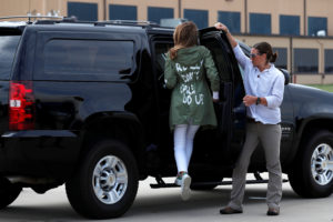 "First lady Melania Trump climbs into her motorcade vehicle wearing a Zara design jacket with the phrase ""I Really Don't Care. Do U?"" on the back as she returns to Washington from a visit to the U.S.-Mexico border area in Texas, at Joint Base Andrews, Maryland, U.S., June 21, 2018. REUTERS/Kevin Lamarque"