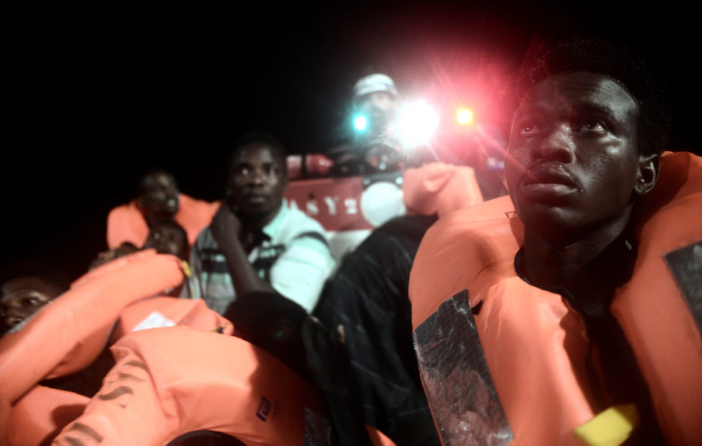 Migrants are rescued by staff members of the MV Aquarius, a search and rescue ship run in partnership between SOS Mediterranee and Medecins Sans Frontieres in the central Mediterranean Sea, June 9, 2018. Picture taken June 9, 2018. Karpov/handout via REUTERS.
