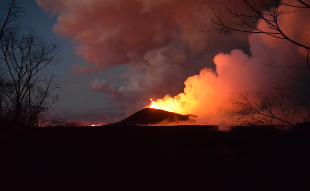 Lava fountains from Kilauea's fissure 8, as viewed from Kupono Street on June 9. The incandescence to the left is from the active lava channel. Photo by U.S. Geological Survey