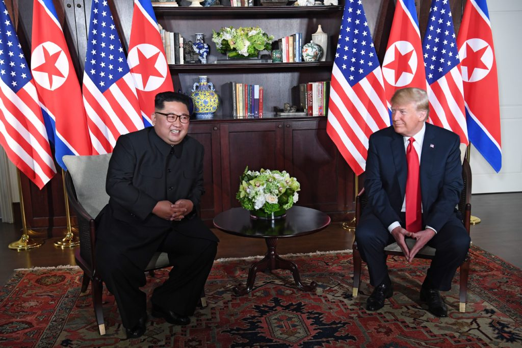 US President Donald Trump (R) and North Korea's leader Kim Jong Un (L) sit down for their historic US-North Korea summit, at the Capella Hotel on Sentosa island in Singapore on June 12, 2018. - Donald Trump and Kim Jong Un have become on June 12 the first sitting US and North Korean leaders to meet, shake hands and negotiate to end a decades-old nuclear stand-off. (Photo by SAUL LOEB / AFP) (Photo credit should read SAUL LOEB/AFP/Getty Images)