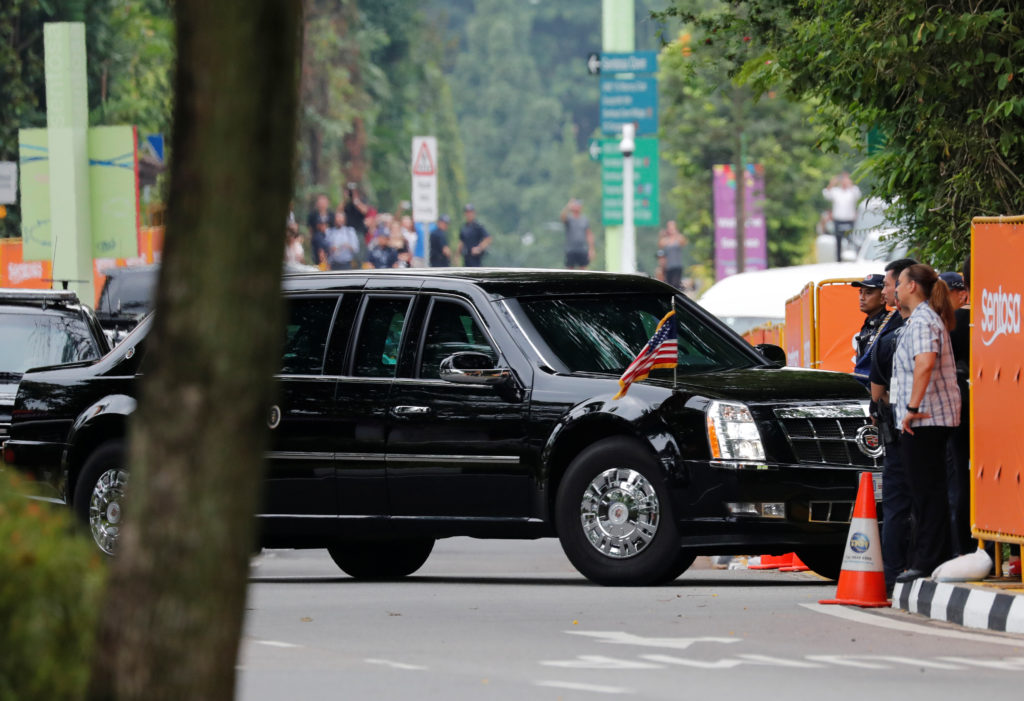 The motorcade of U.S. President Donald Trump arrives at the Capella hotel, the venue of the summit between North Korea and the U.s., on Sentosa island in Singapore June 12, 2018. REUTERS/Kim Kyung-hoon