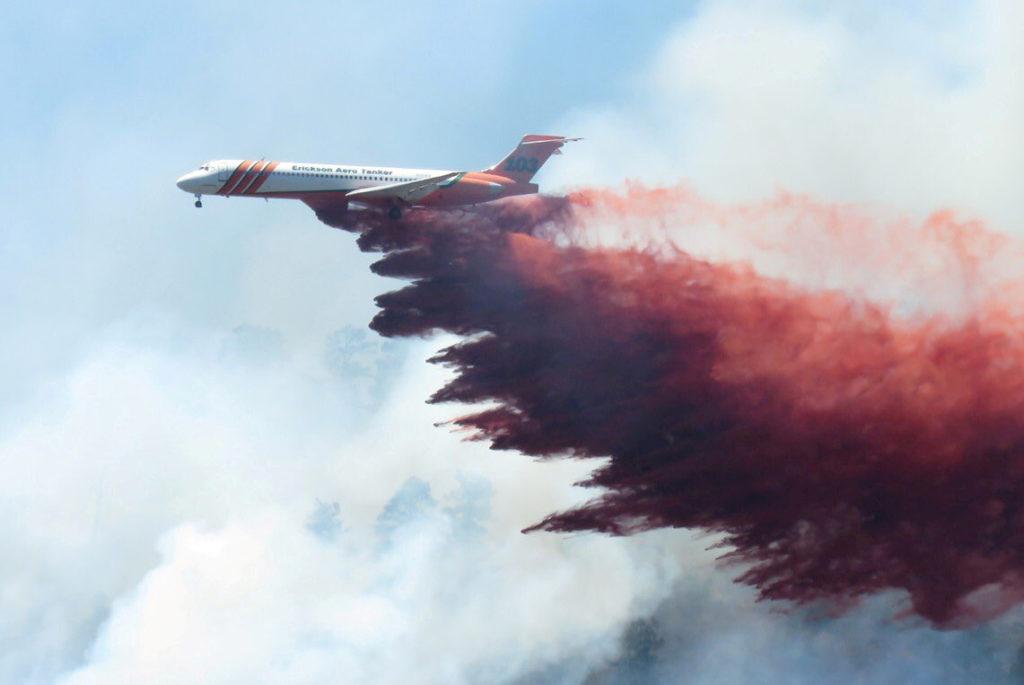A plane drops fire-retardant chemicals on the 416 Fire near Durango, Colorado, U.S. in this June 9, 2018 handout photo. La...
