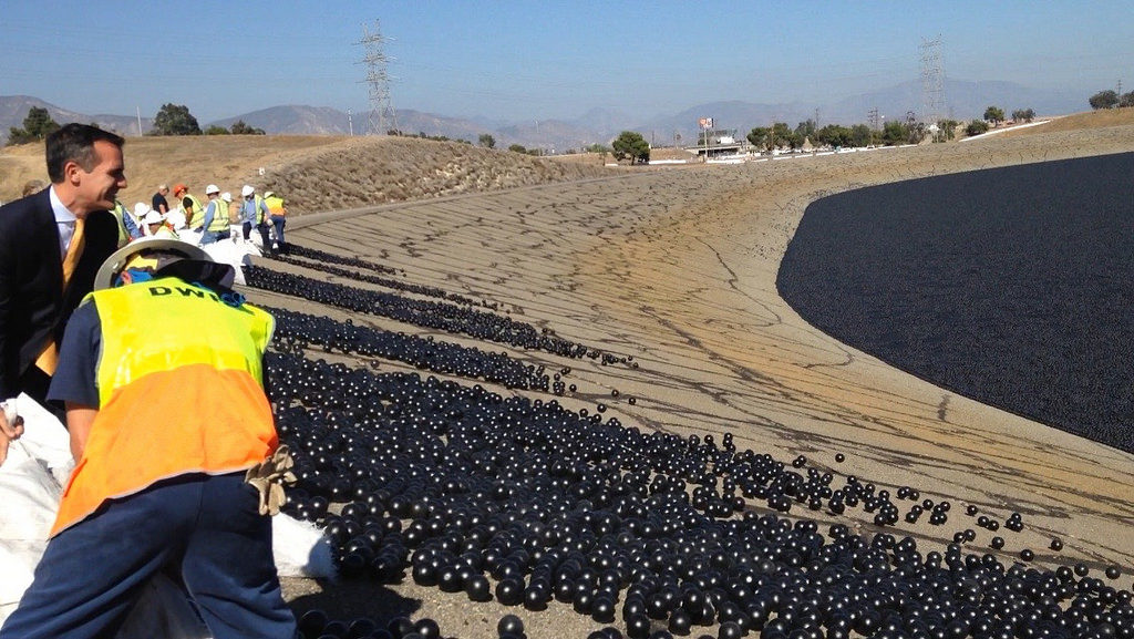 "In 2015, 96 million black plastic ""shade balls"" were dumped into the Los Angeles Reservoir to improve water quality and save a little water. Image by Eric Garcetti/via Flickr"