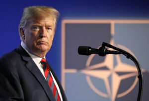 President Donald Trump looks on as he holds a news conference after participating in the NATO Summit in Brussels, Belgium. Photo by Reinhard Krause/Reuters