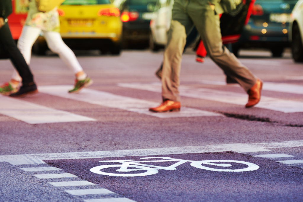 Pedestrian deaths jumped 27 percent from 2007 to 2016 while other U.S. traffic deaths dropped. Distracted walking, and alcohol consumption by drivers and pedestrians are contributing to the problem, federal data shows. Photo by Getty Images