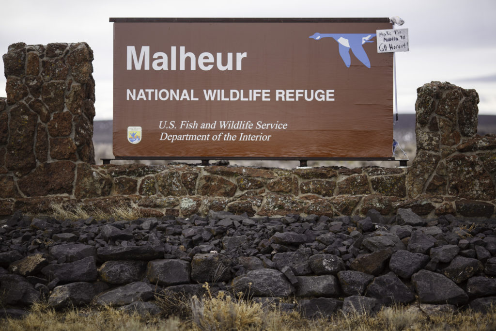 A mop and sign are taped to a sign for the occupied Malheur National Wildlife Refuge near Burns, Oregon on Jan. 29, 2016. Photo by Rob Kerr/AFP/Getty Images