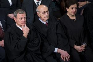 "The Supreme Court Justices, from bottom left, Chief Justice John Roberts, Stephen Breyer, and Elena Kagan listen during a State of the Union address to a joint session of Congress at the U.S. Capitol in Washington, D.C., U.S., on Tuesday, Jan. 30, 2018. President Donald Trump sought to connect his presidency to the nation's prosperity in his first State of the Union address, arguing that the U.S. has arrived at a ""new American moment"" of wealth and opportunity. Photographer: Al Drago/Bloomberg via Getty Images"