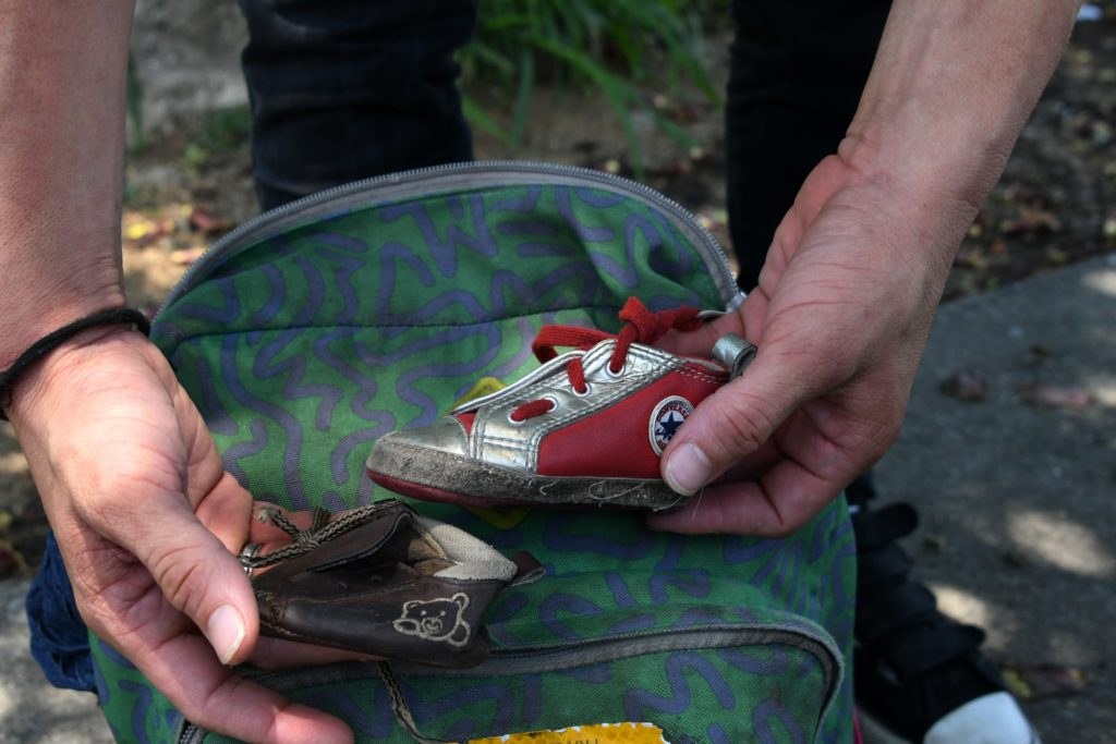 Honduran immigrant Ever Sierra, 28, shows two little shoes that belong to his baby-girl, after being deported from the US ...