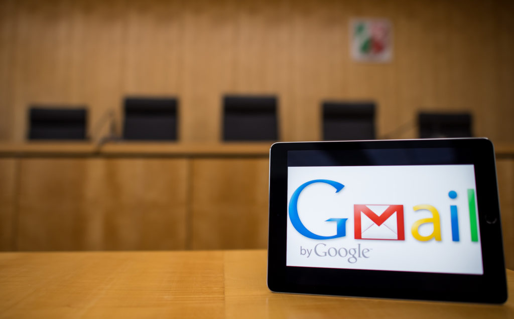 ILLUSTRATION - 26 February 2018, Germany, Muenster: An iPad with the logo of the Google service Gmail stands on a table at the Higher Adrministrative Court. The court negotiates the dispute between Google and the the German Federal Network Agency (BNetzA). After a notice from 2012, Google has to register its E-Mail service Gmail as telecommunication service. This would have consequences for data protection requirements and observation interfaces for German authorities. Google sued against this but lost the case in the first instance in front of the Administrative court Cologne. Photo: Guido Kirchner/dpa (Photo by Guido Kirchner/picture alliance via Getty Images)