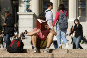 A student reads on the campus of Columbia University in New York. Photo by Mike Segar/Reuters