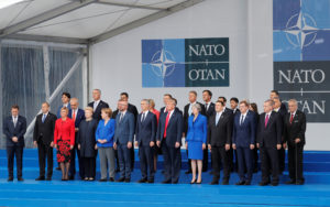 NATO leaders pose for a family photo at the start of the NATO summit in Brussels, Belgium, on July 11, 2018. Photo by Yves Herman/Reuters