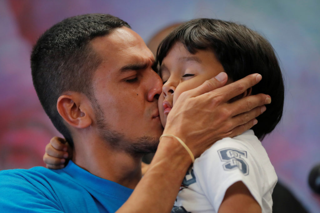 Javier, a 30 year old from Honduras, holds his 4-year old-son William during a July news conference in New York after they were reunited after being separated for 55 days following their detention at the Texas border. Photo by Lucas Jackson/Reuters