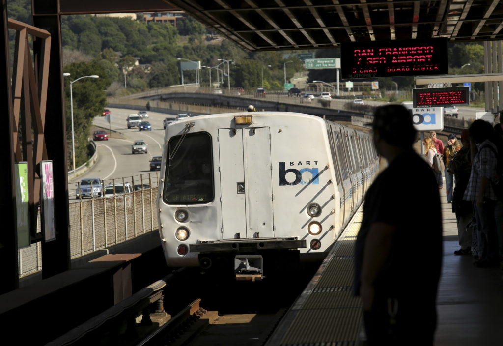 Passengers await the arrival of a Bay Area Rapid Transit (BART) train at the Rockridge station in Oakland, California. Photo taken in 2015. Photo by Robert Galbraith/Reuters