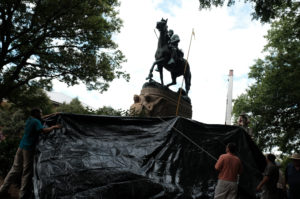 Workers from the City of Charlottesville Parks Department cover the statue of Confederate General Stonewall Jackson in a black tarp in Charlottesville, Virginia. Photo taken in August 2017. Photo by Justin Ide/Reuters