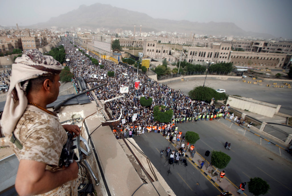 A Houthi fighter secures a rally to denounce the Saudi-led coalition's offensive on the Red Sea coast areas, in Sanaa, Yemen. Photo by Mohamed al-Sayaghi/Reuters
