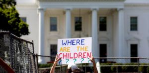 An immigration activists hold signs against family separation during a rally to protest against the Trump Administration's immigration policy outside the White House in Washington, D.C. Photo by Joshua Roberts/Reuters