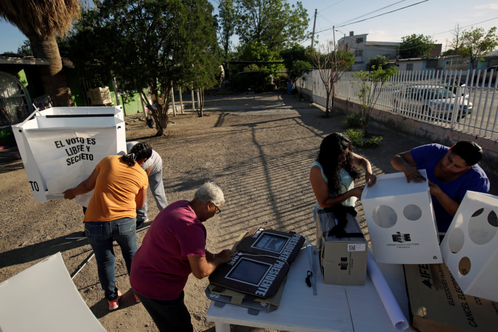 Poll workers assemble ballot boxes at a polling station during the presidential election in Ciudad Juarez, Mexico July 1, 2018. Photo by Jose Luis Gonzalez/Reuters