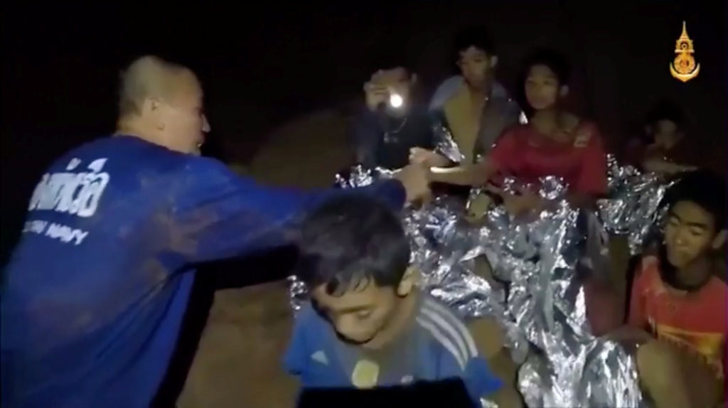 A medic treats the boys in Chiang Rai, Thailand, in this still image taken from a July 3 video by a Thai Navy Seal. Thai Navy Seal/Handout via Reuters TV