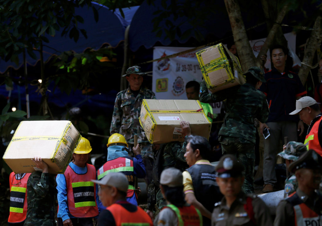Soldiers and rescue workers carry supplies and food to the caves. Photo by Soe Zeya Tun/Reuters