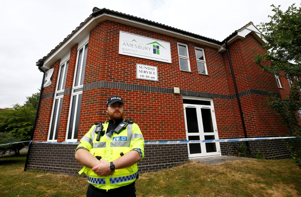 A police officer stands in front of Amesbury Baptist Church, which has been cordoned off after two people were hospitalised and police declared a 'major incident', in Amesbury, Wiltshire, Britain. Photo by Henry Nicholls/Reuters