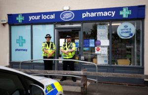 Police officers guard outside a branch of Boots pharmacy, which has been cordoned off after two people were hospitalized and police declared a 'major incident', in Amesbury, Wiltshire in Britain. Photo by Henry Nicholls/Reuters