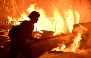 Firefighters battle a fast-moving wildfire that destroyed homes driven by strong wind and high temperatures forcing thousands of residents to evacuate in Goleta, California. Photo by Gene Blevins/Reuters