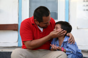 Walter Armando Jimenez Melendez, an asylum seeker from El Salvador, arrives with his four year-old son Jeremy at La Posada Providencia shelter in San Benito, Texas, U.S., shortly after he said they were reunited following separation since late May while in detention, on July 10. Photo by Loren Elliott/Reuters