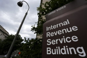 A security camera hangs near a corner of the U.S. Internal Revenue Service (IRS) building in Washington, D.C., in 2015. Photo by Jonathan Ernst/Reuters