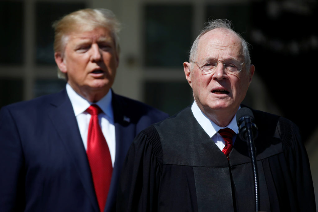 U.S. President Donald Trump listens as Justice Anthony Kennedy speaks before swearing in Judge Neil Gorsuch as an Associate Supreme Court Justice in the Rose Garden of the White House in Washington, U.S., April 10, 2017. REUTERS/Joshua Roberts - RC15570B9710